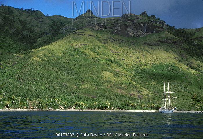 Coastal view of Yasawa Group island with boat moored near shore Fiji South Pacific  -  Julia Bayne/ npl
