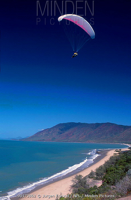 Paraglider flies over beach Queensland Australia  -  Jurgen Freund/ npl