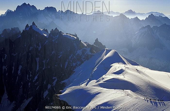 Climbers crossing the Plan de lAiguille Aiguille du Midi Alps France  -  Eric Baccega/ npl