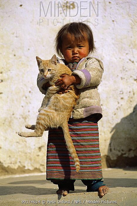 Child holding kitten, Thimpu, Bhutan 2001  -  Pete Oxford/ npl