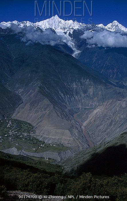 Mount Kawagebo with river and valley below Yunnan province, China  -  Xi Zhinong/ npl