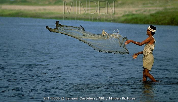 Fisherman throwing net Majuli island Assam India  -  Bernard Castelein/ npl