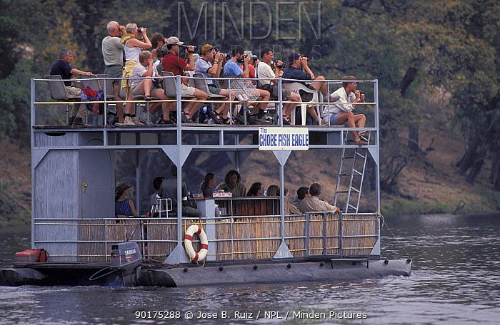 Tourists viewing from boat Chobe NP Botswana reserve  -  Jose B. Ruiz/ npl