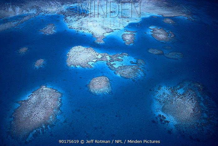 Aerial view of fringing coral reefs, Palau Islands, Micronesia  -  Jeff Rotman/ npl