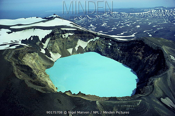 Aerial view looking down into blue sulphuric, hydrochloric lake in volcanic crater, Kamchatka, Russia  -  Nigel Marven/ npl