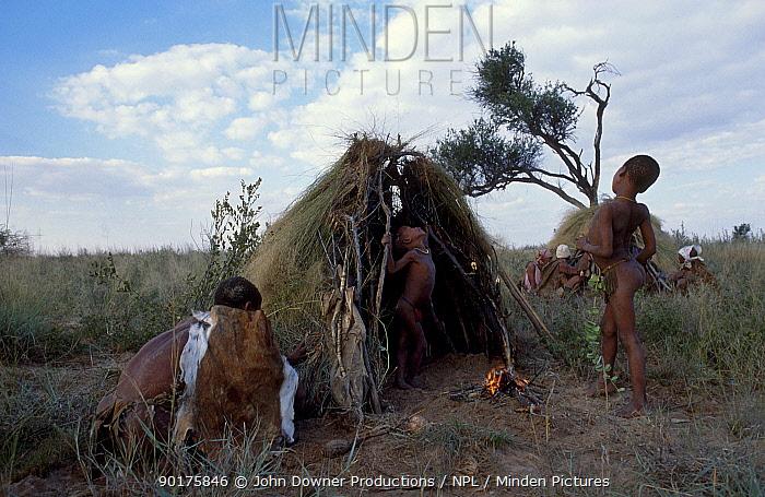San bushman family by huts Kalahari Botswana Southern Africa  -  John Downer/ npl
