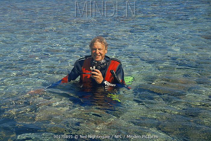 Sir David Attenborough in scuba gear, Heron Island Australia On location for Private Life of Plants 1990s  -  Neil Nightingale/ npl