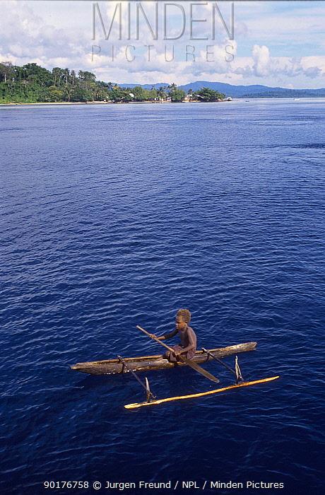 Papuan boy in outrigger canoe Bismark sea Papua New Guinea  -  Jurgen Freund/ npl
