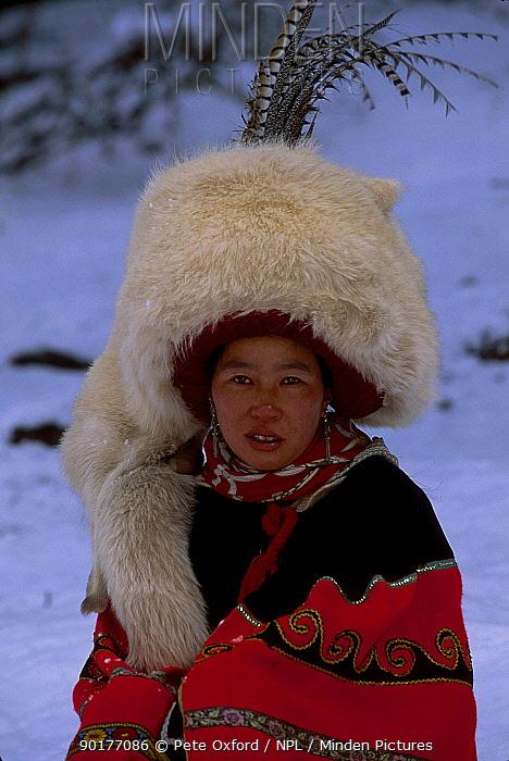 Nosi Yi woman in White fox hat (not traditional Red Panda fur) Lijiang Yunnan China  -  Pete Oxford/ npl