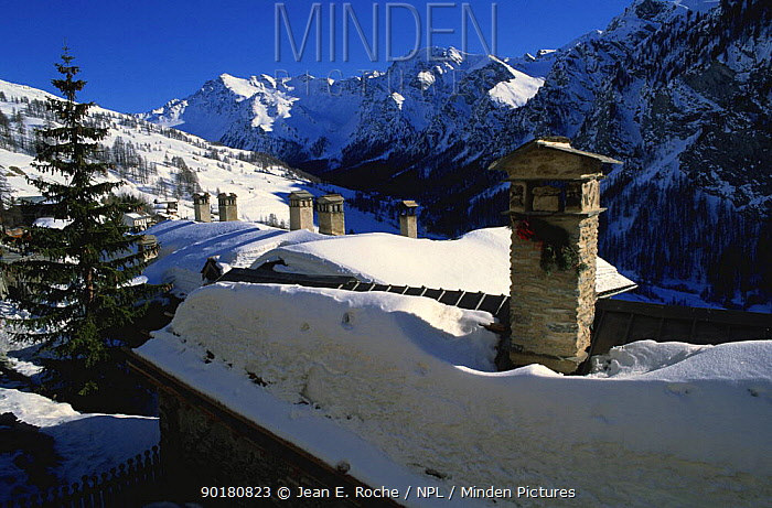 Thick snow on rooftops, St Veran, Queyras regional nature park, Alps, France  -  Jean E. Roche/ npl