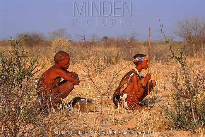 Bushmen rest from tracking Bushmanland Namibia  -  Keith Scholey/ npl