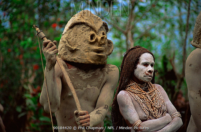 Asaro mudman with wife at traditional dance ceremony, Mount Hagen, Papua New Guinea, 1991  -  Phil Chapman/ npl