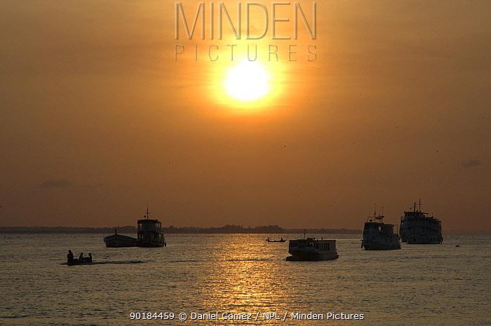 Boats on the Tapajos River at sunrise Santarem, Brazil  -  Daniel Gomez/ npl
