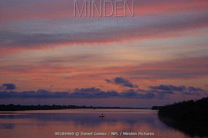 Man fishing in the Rio Negro at sunrise, Brazil  -  Daniel Gomez/ npl