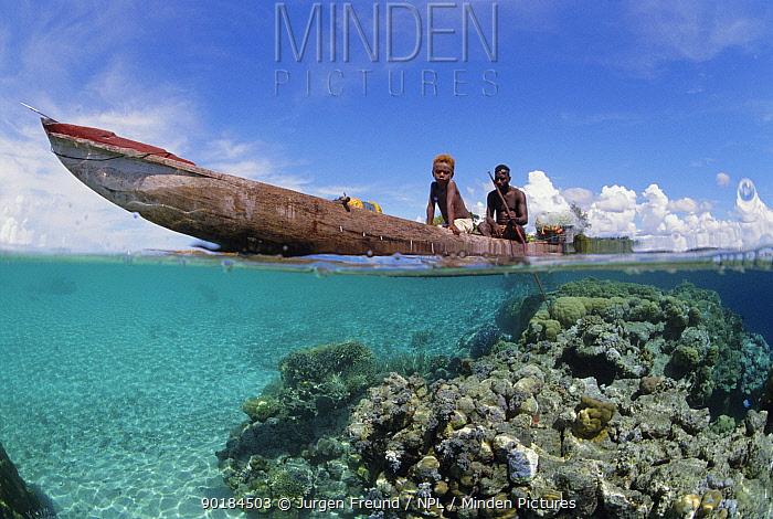 Papuan fisherman and son in outrigger canoe, split level Papua New Guinea  -  Jurgen Freund/ npl