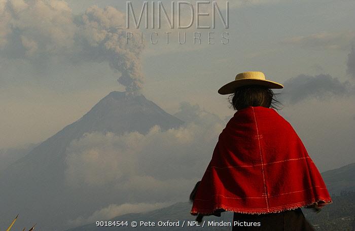 Salasacan indian with Tungurahua volcano smoking in background, Andes, Ecuador  -  Pete Oxford/ npl