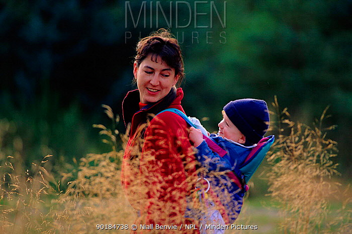 Children encountering nature, 1 year old in forest in backpack Montreathmont, Angus, Scotland, UK, Europe  -  Niall Benvie/ npl