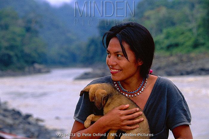 Machiguenga Indian and pet dog, Timpia Community, Lower Urubamba river, Peru Amazonia  -  Pete Oxford/ npl
