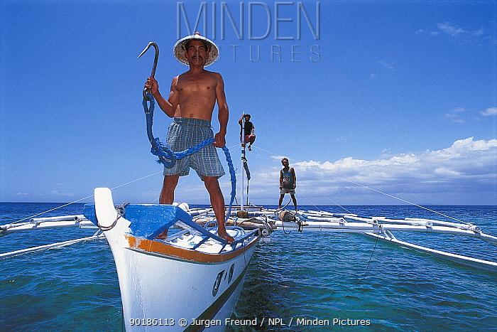 Whale shark hunter on boat with fish hook, Pamilacan, Bohol, Philippines 1997  -  Jurgen Freund/ npl