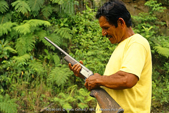 Colonizers holding a gun, Ecuadorian Amazon, 1994  -  Pete Oxford/ npl