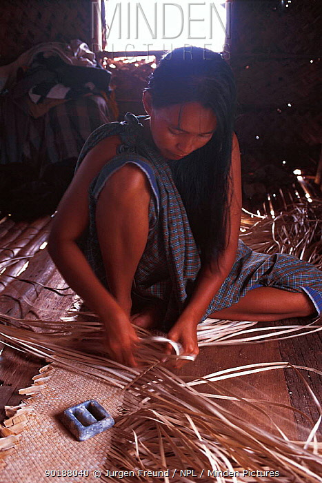 Bajau woman weaving mats, Malaysia Bajau people live in houses on stilts or are nomadic in houseboats 2000  -  Jurgen Freund/ npl