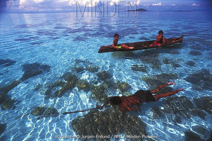 Bajau fisherman spear fishing underwater Malaysia Nomadic tribe who live on the sea  -  Jurgen Freund/ npl