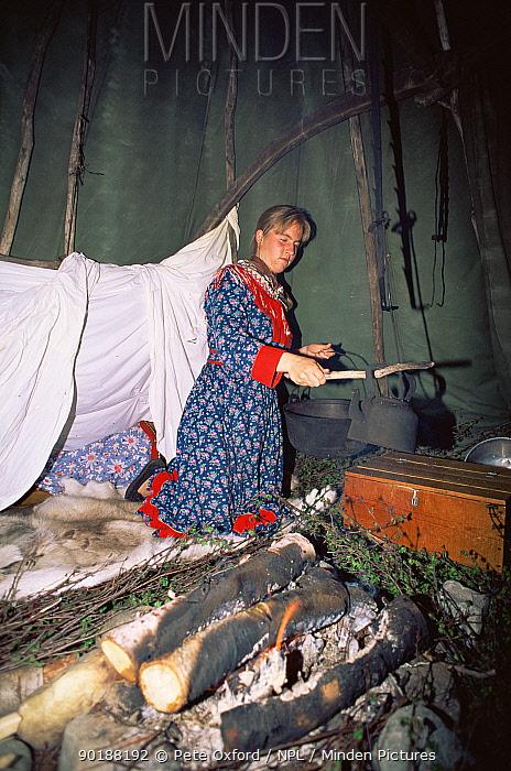 Sami cooking on open fire in lavu (tent), Karaskok, Samiland, Lapland, Finnmark, North Norway 1997  -  Pete Oxford/ npl