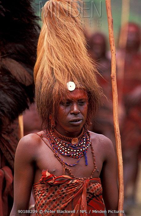 Masai warrior wearing headress made from Lion's mane, Eunoto ceremony, Mara, Kenya  -  Peter Blackwell/ npl