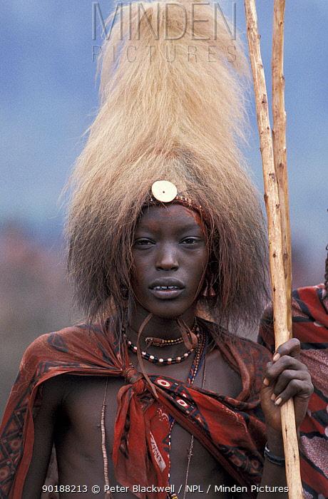 Masai warrior wearing headress made of Lions mane, Eunoto ceremony, Kenya  -  Peter Blackwell/ npl
