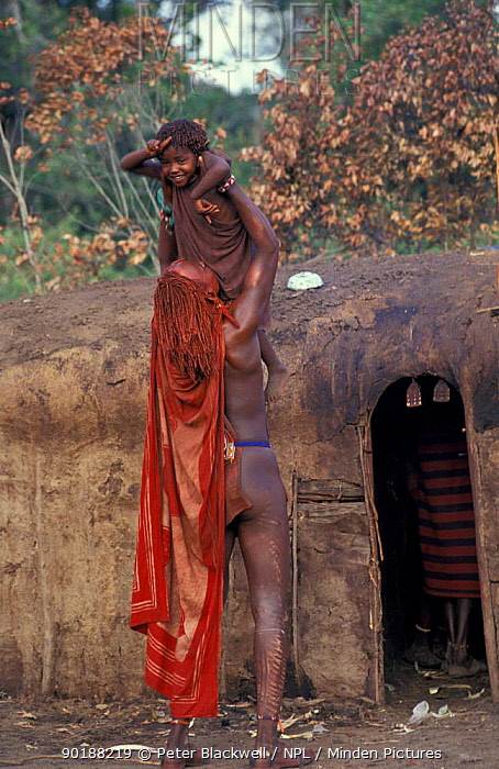 Masai warrior holding boy, Eunoto ceremony, Mara, Kenya  -  Peter Blackwell/ npl