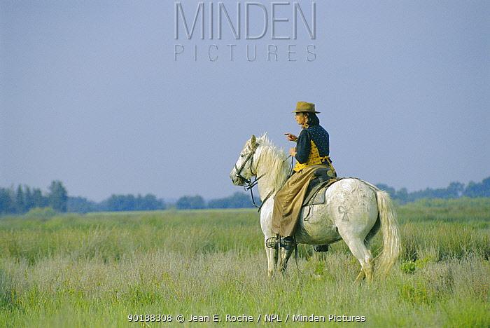 Woman riding white horse, Camargue, France  -  Jean E. Roche/ npl