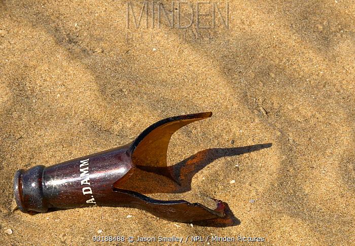 Broken bottle on beach, UK  -  Jason Smalley/ npl