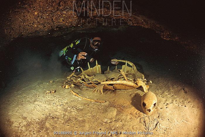 Diver investigates Green turtle skeleton in cave (Chelonia mydas) Sipadan, Malaysia, Indo Pacific ocean  -  Jurgen Freund/ npl