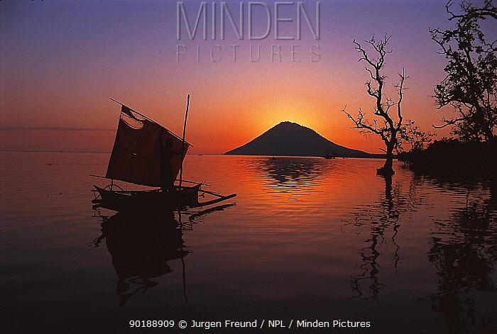 Silhouette of boat and Manado Tua island, Sulawesi, Indonesia  -  Jurgen Freund/ npl