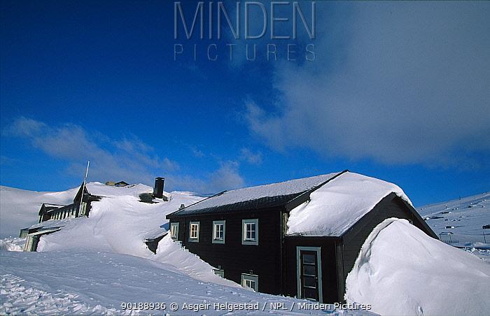 Mountain hut after snow storm Finse, Hardangervidda, Norway  -  Asgeir Helgestad/ npl