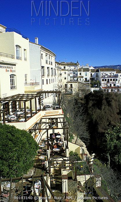 People eating on balconies of houses in hilltop village, Ronda, Andalucia, Spain  -  Jose B. Ruiz/ npl