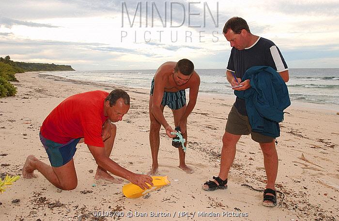 Litter survey on Henderson Is, Pitcairn Is, South Pacific  -  Dan Burton/ npl