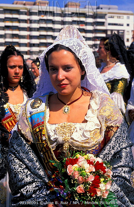 Woman in traditional costume with flower offerings, Fallas Valencia Festival 2003, Spain  -  Jose B. Ruiz/ npl