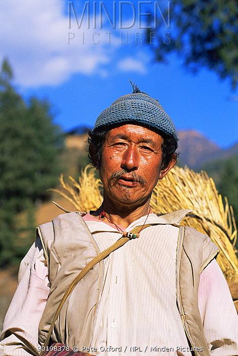 Local peasant farmer, Paro Valley, Bhutan 2001  -  Pete Oxford/ npl