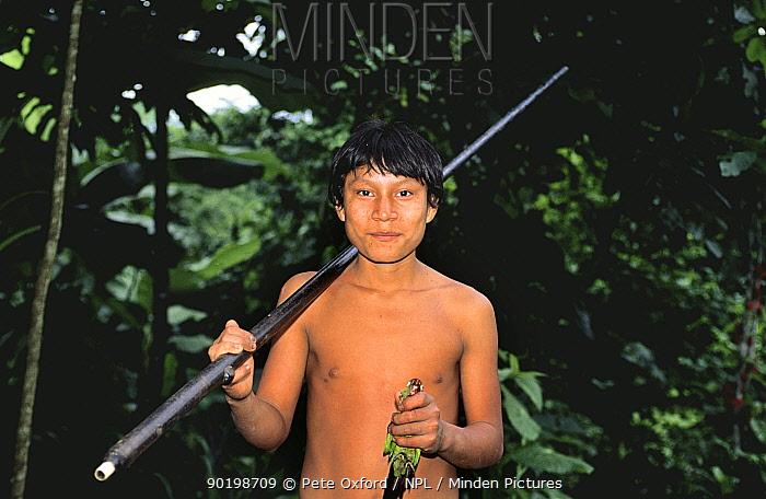 Young Quichua Indian with blow gun and dead Maroon tailed parakeet prey, Ecuadorian Amazon  -  Pete Oxford/ npl
