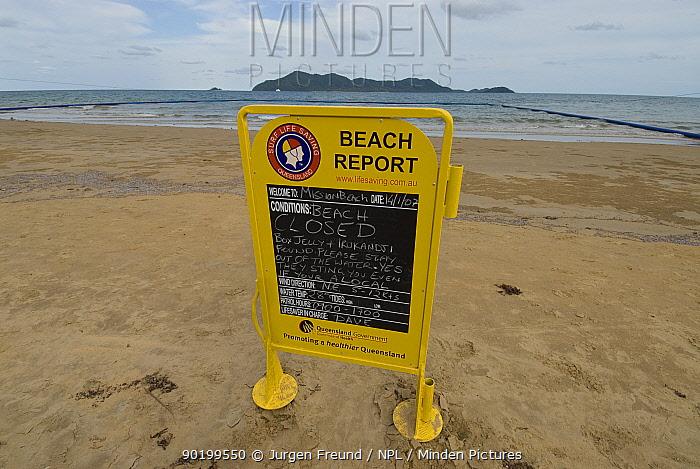 Beach report board infront of stinger-resistant enclosure, warning people not to swim because of Irukandji and Box Jellyfish, Queensland, Australia  -  Jurgen Freund/ npl