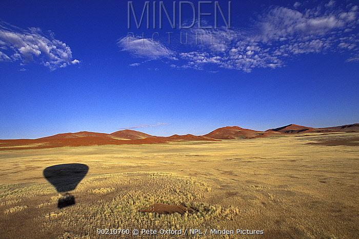 Hot air balloon shadow over plains, Sossusvlei, Namib-Naukluft NP, Namibia  -  Pete Oxford/ npl