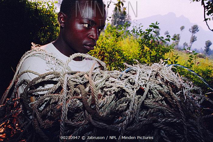 Ranger with poachers' snares confiscated from Ruhengeri district, Parc des Volcans NPark, Rwanda, Parc des Volcans  -  Jabruson/ npl