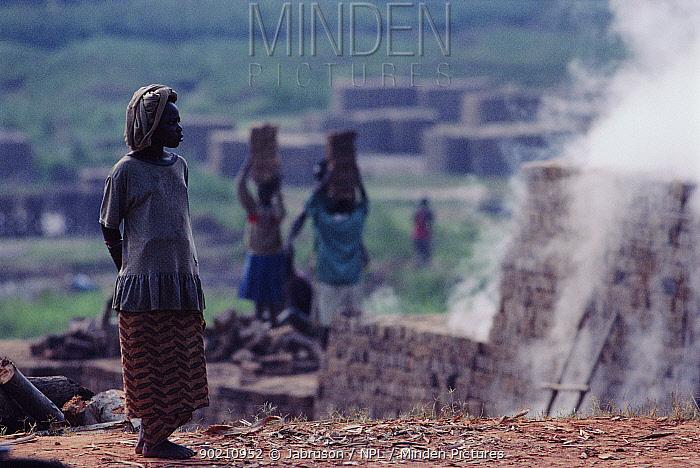 Rwandan women collecting bricks at brick kiln, Kinigi, Ruhengeri, Rwanda  -  Jabruson/ npl