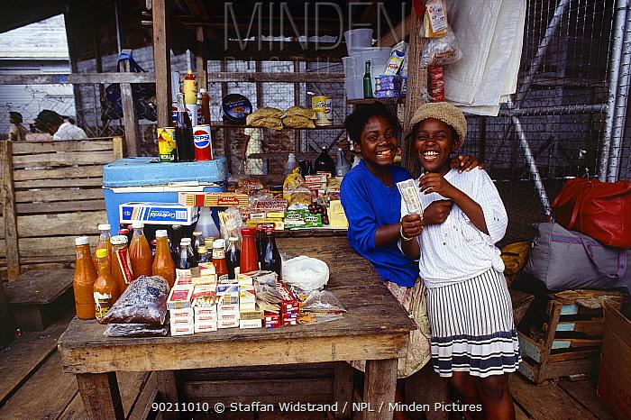 Two girls at market stall, Georgetown, Guyana, South America  -  Staffan Widstrand/ npl