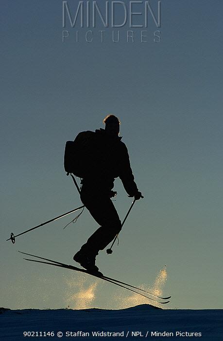 Cross country skiing jumping, ecotourism, Grovelsjon NR, Dalarna, Sweden  -  Staffan Widstrand/ npl