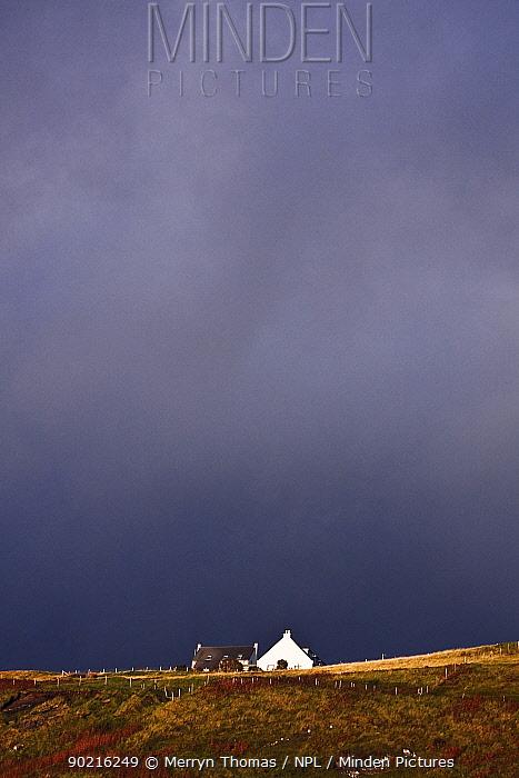 Lone house beneath stormy skies Elgol, Isle of Skye, Scotland September 2010  -  Merryn Thomas/ npl