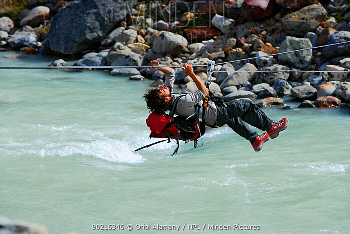 Minden Pictures stock photos - Alpinist mountaineer crossing the ...