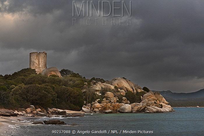 Figari bay and medieval watchtower, with dark storm clouds, Southern coast of Corsica island, Bonifacio, France, Febraury 2010  -  Angelo Gandolfi/ npl