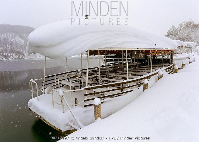 Tourists' boats covered in snow, on Lake Kozjac, Plitvice Lakes National Park, Croatia  -  Angelo Gandolfi/ npl